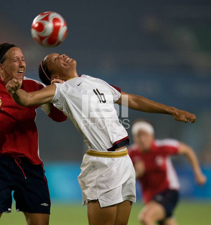 USWMNT midfielder (16) Angela Hucles goes up for a header in the box with Norwegian captain (2) Ane Stangeland during first round play for the 2008 Beijing Olympics in Qinhuangdao, China. .  The US lost to Norway, 2-0, at Qinhuangdao Stadium.