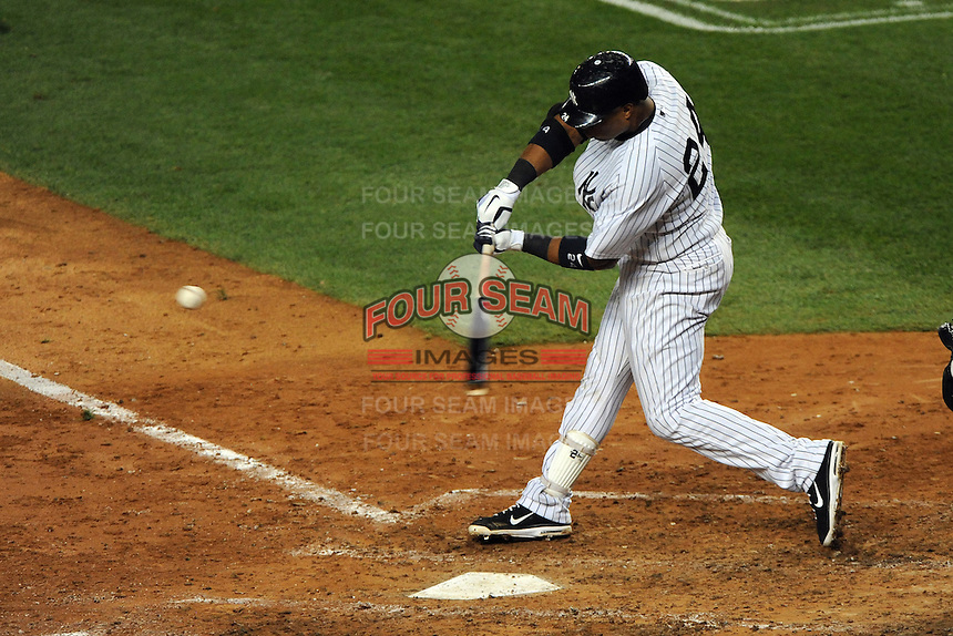 New York Yankees second baseman Robinson Cano #24 hits a homerun during ALDS game #5 against the Detroit Tigers at Yankee Stadium on October 06, 2011 in Bronx, NY.  Detroit defeated New York 3-2 to take the series 3 games to 2 games.  Tomasso DeRosa/Four Seam Images