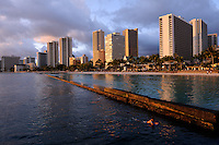 Downtown Honolulu and Waikiki beach at sunset