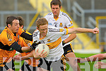 Crokes Colm Cooper holds off Stacks Michael Collins during the quarter final dual in Fitzgerald Stadium on Sunday