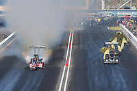 Feb. 24, 2013; Chandler, AZ, USA; NHRA top fuel dragster driver Brittany Force (right) alongside David Grubnic during the Arizona Nationals at Firebird International Raceway. Mandatory Credit: Mark J. Rebilas-