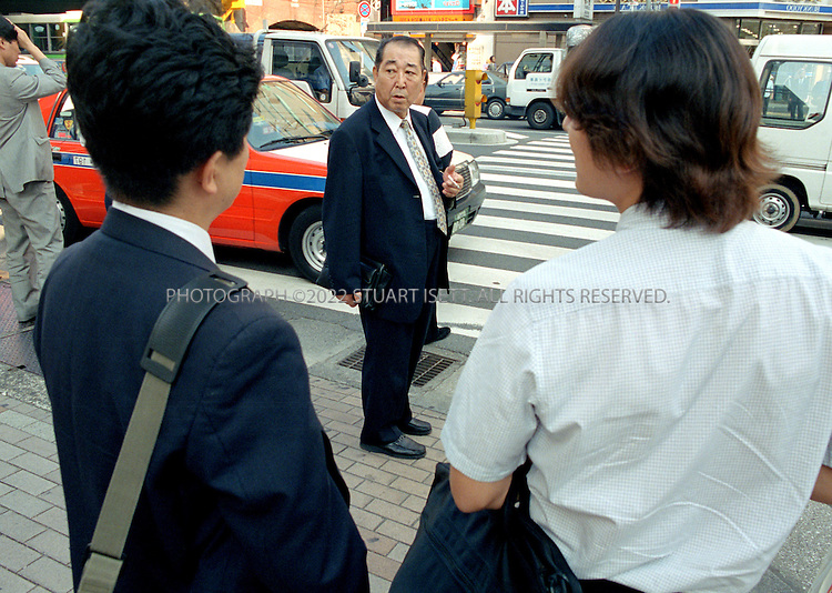 8/10/2001--Tokyo, Japan..Once held up as corporate samurais, the Japanese salaryman has fallen on hard times. Blamed for Japan's economic ills these office workers are accused of lacking creativity and being unproductive. With unemployment reaching record highs many face unemployment and humiliation. Suicides and depression run high among Japan's salaried employees....All photographs ©2003 Stuart Isett.All rights reserved.This image may not be reproduced without expressed written permission from Stuart Isett.
