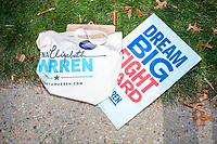 """A campaign sign reading """"Dream Big / Fight Hard"""" and a Warren campaign totebag are seen on the ground before Democratic presidential candidate and Massachusetts senator Elizabeth Warren files paperwork to get on the primary ballot at the NH State House in Concord, New Hampshire, on Wed., November 13, 2019. Warren also held a small rally outside the State House after filing her paperwork."""