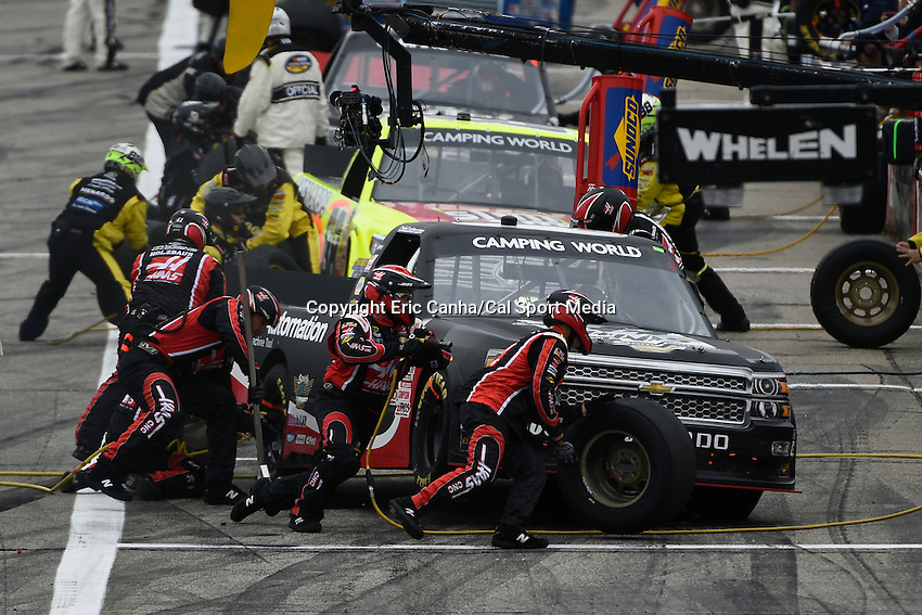 September 19, 2014 - Loudon, New Hampshire, U.S. -  Cole Custer, NASCAR Camping World Truck Series driver of the #00 Haas Automation Chevy truck does a pit stop during the NASCAR Camping World Truck Series UNOH 175 race held at the New Hampshire Motor Speedway in Loudon, New Hampshire.   Eric Canha/CSM