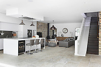 An open-plan kitchen and sitting area in the basement, accessed via a staircase, or sllde