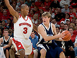 MADISON, WI - NOVEMBER 3: Guard Trevon Hughes #3 of the Wisconsin Badgers plays defense against the University of Wisconsin-Stout Blue Devils at the Kohl Center on September 3, 2006 in Madison, Wisconsin. The Badgers beat the Blue Devils 82-33. Photo by David Stluka