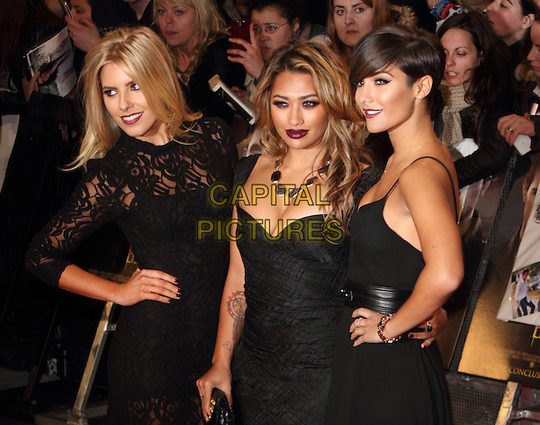 The Saturdays - Mollie King, Vanessa White & Frankie Sandford.'The Twilight Saga: Breaking Dawn Part 2' European film premiere, Empire cinema, Leicester Square, London, England..14th November 2012.half length black dress lace belt hand on hip side  cleavage band group.CAP/ROS.©Steve Ross/Capital Pictures