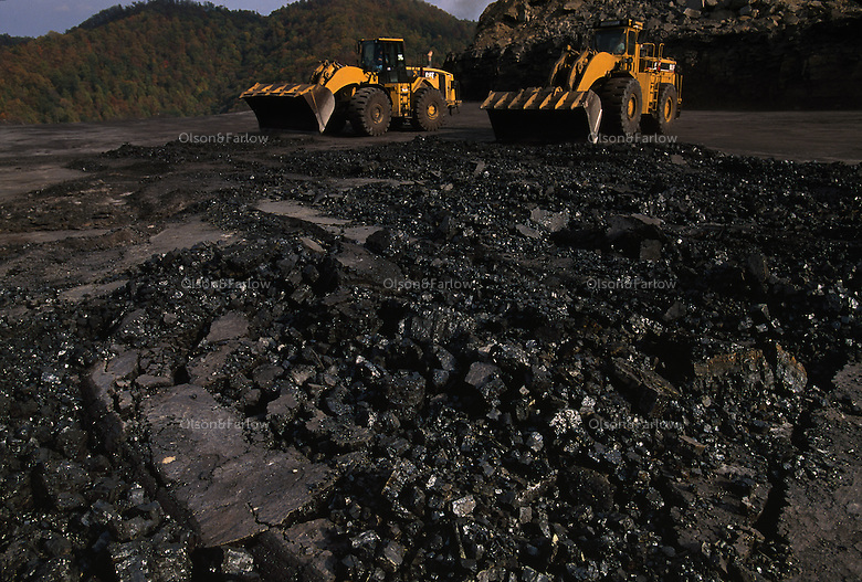A miner uses a bulldozer to break up a seam of coal at a small mine sit.