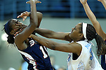 11 November 2012: North Carolina's Xylina McDaniel (34) puts her hands into the face of Duquesne's Ahjah Hall (11) after passing the ball. The University of North Carolina Tar Heels played the Duquesne University Dukes at Carmichael Arena in Chapel Hill, North Carolina in an NCAA Division I Women's Basketball game, and a quarterfinal in the Preseason WNIT. UNC won the game 62-58