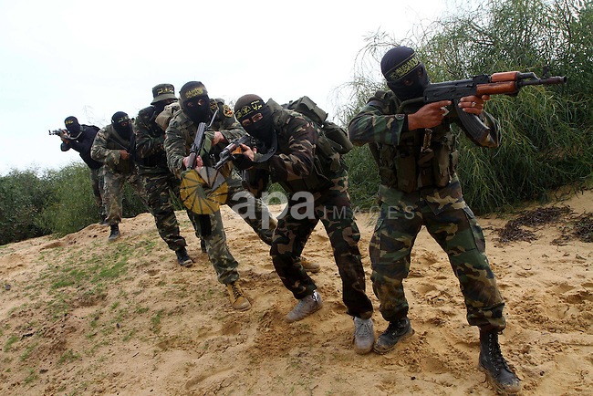 Palestinian Islamic Jihad militants participate in a training session in the outskirts of Khan Younis, southern Gaza Strip, Thursday, Feb. 10, 2011. Islamic Jihad carried out dozens of suicide bombings and other attacks against Israel. It is smaller than Hamas, the main militant group, which rules the Gaza strip.. Photo by Ashraf Amra