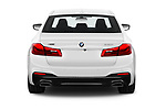 Straight rear view of 2019 BMW 5-Series M-Sport 4 Door Sedan Rear View  stock images