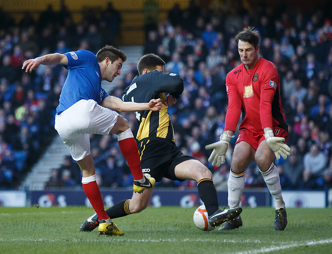 Andy Little pounces to score the opening goal for Rangers beating Berwick defender Chris Townsley and keeper Ian McCaldon
