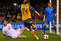 MELBOURNE, AUSTRALIA - JUNE 7: Brett Holman of the Socceroos kicks for goal during an international friendly match between the Qantas Australian Socceroos and Serbia at Etihad Stadium on June 7, 2011 in Melbourne, Australia. Photo by Sydney Low / AsteriskImages.com