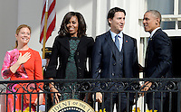 United States President Barack Obama, right, First Lady Michelle Obama, left center, and Prime Minister Justin Trudeau of Canada, right center, and and Mrs. Sophie Gregoire Trudeau, left, wave from the South Portico of the White House following an Arrival Ceremony in Washington, DC on Thursday, March 10, 2016. Photo Credit: Olivier Douliery/CNP/AdMedia