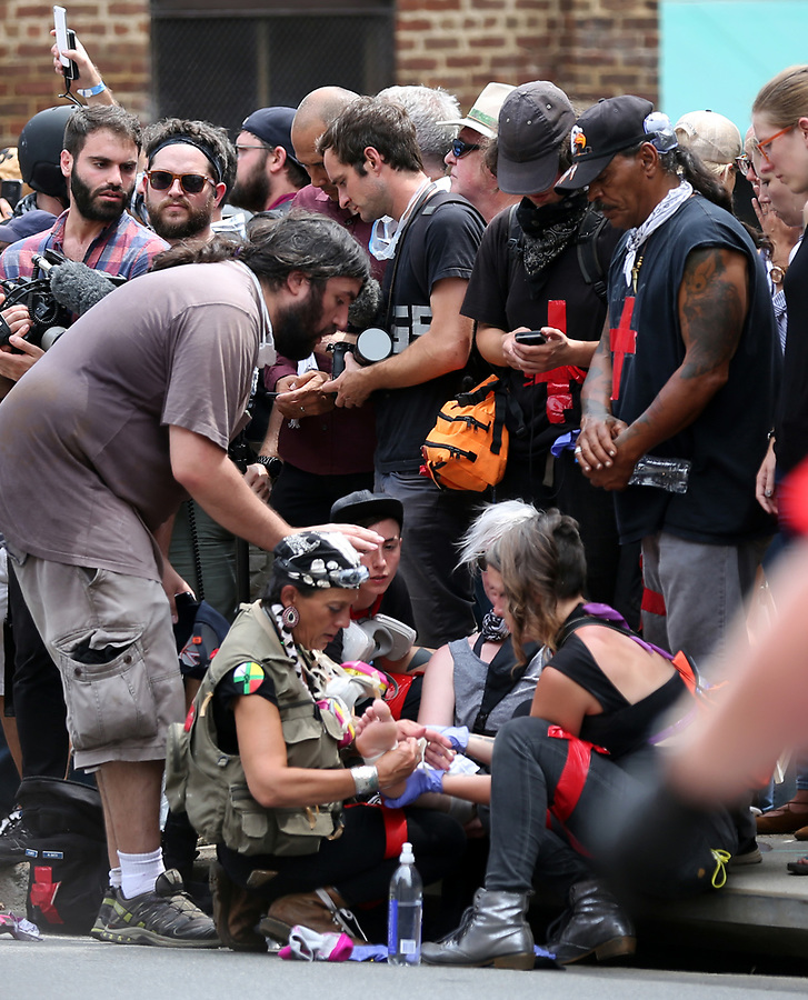 Chaotic scene after a car smashes through a crowd of people on 4th Street SE hours after Unite The Right rally in Charlottesville, Va. Photo/Andrew Shurtleff