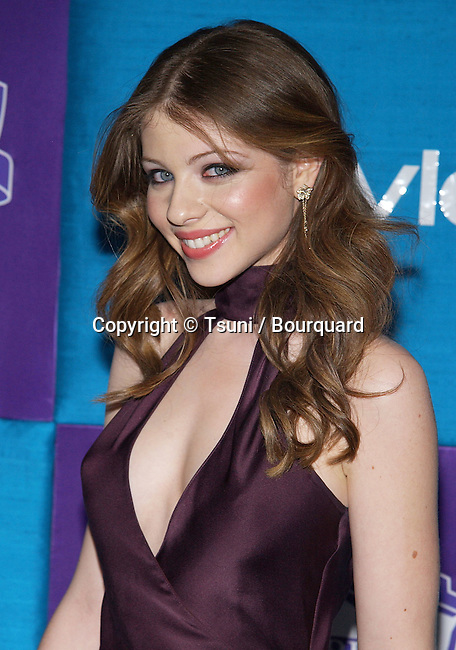 Michelle Trachtenberg arriving In Style Warner Party at the Golden Globes Awards  Los Angeles. January 16, 2005.