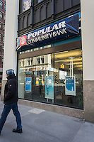 A closed New York branch of the Puerto Rico based Doral Bank on Saturday, February 28, 2015. The troubled bank has been closed by the Federal Deposit Insurance Corp. with the banking operation sold to Banco Popular de Puerto Rico. Doral was the fourth bank in the U.S. to fail this year with 26 branches, three in New York. and five in Florida. (© Richard B. Levine)