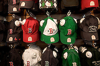 Boston Red Sox merchandise hangs on a wall for sale in a shop near Fenway Park in Boston, Massachusetts, USA.