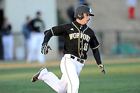 Second baseman Alec Paradowski (15) of the Wofford College Terriers runs toward first in a game against the Boston College Eagles on Friday, February 13, 2015, at Russell C. King Field in Spartanburg, South Carolina. Wofford won, 8-4. (Tom Priddy/Four Seam Images)