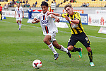 Perth Glory's Matthew Davies, left and Phoenix's Tyler Boyd, right, battle each other to the ball in the A-League football match at Westpac Stadium, Wellington, New Zealand, Sunday, March 09, 2014. Credit: Dean Pemberton