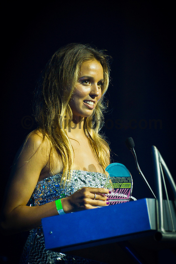 GOLD COAST, Queensland/Australia (Friday, February 24, 2012) Sally Fitzgibbons (AUS).   The 29th Annual ASP World Surfing Awards went off tonight at the Gold Coast Convention and Exhibition Centre with the worlds best surfers trading the beachwear for formal attire as the 2011 ASP World Champions were officially crowned.. .Kelly Slater (USA), 40, and Carissa Moore (HAW), 19, took top honours for the evening, collecting the ASP World Title and ASP Womens World Title respectively.. .I have actually been on tour longer than some of my fellow competitors have been alive, Slater said. All joking aside, its truly humbling to be up here and honoured in front of such an incredible collection of surfers. I want to thank everyone in the room for pushing me to where I am...In addition to honouring the 2011 ASP World Champions, the ASP World Surfing Awards included new accolades voted on by the fans and the surfers themselves...For the first time in several years, ASP Life Membership was awarded to Hawaiian legend and icon of high-performance surfing, Larry Bertlemann (HAW), 56...Where surfing is today is where I dreamed it should be in the 70s, Bertlemann said. You guys absolutely deserve this and Im so honored to be up here in front of you all tonight..Grammy Award-winning artists Wolfmother and The Vernons rounded out the nights entertainment which was all streamed LIVE around the world on YouTube.com..Photo: joliphotos.com