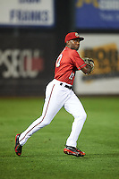 Harrisburg Senators outfielder Derrick Robinson (12) throws the ball in during a game against the New Hampshire Fisher Cats on July 21, 2015 at Metro Bank Park in Harrisburg, Pennsylvania.  New Hampshire defeated Harrisburg 7-1.  (Mike Janes/Four Seam Images)