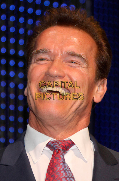 Governor of California ARNOLD SCHWARZENEGGER.Opening ceremony of the world's biggest high-tech fair, the CeBIT, Hanover, Germany..March 2nd, 2009.Schwarzeneger headshot portrait laughing  .CAP/PPG/compb.© compb /People Picture/Capital Pictures