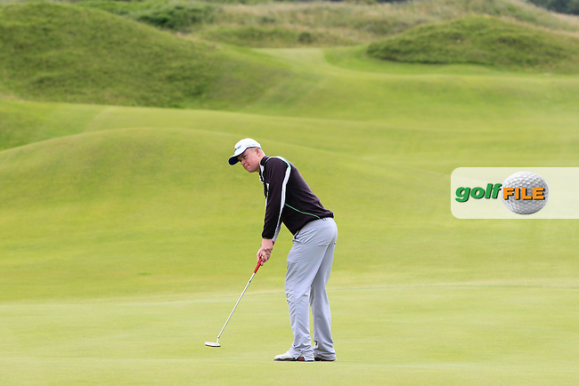 Sam Sweeney (Seapoint) on the 5th green during Round 2 of the North of Ireland Amateur Open Championship at Royal Portrush, Dunluce Course on Tuesday 14th July 2015.<br /> Picture:  Thos Caffrey / www.golffile.ie