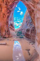 Reflections in muddy water, Navajo Arch, Arches National Park, Utah Devils Garden