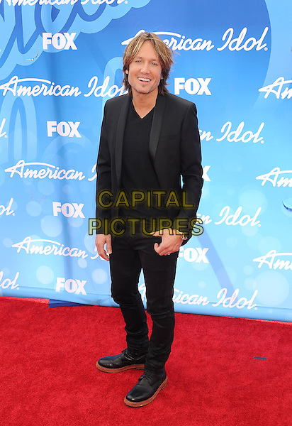 "Keith Urban.arriving at FOX's ""American Idol"" Grand Finale at Nokia Theatre L.A. Live in Los Angeles, California, USA,.May 16th 2013..full length suit jacket blazer black.CAP/ROT/TM.©Tony Michaels/Roth Stock/Capital Pictures"