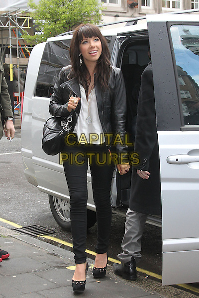 Carly Rae Jepsen visits the studios of BBC Radio 1, London, England..April 18th, 2012.full length black jeans denim shoes leather jacket white shirt bag purse car.CAP/HIL.©John Hillcoat/Capital Pictures.