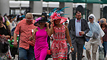 LOUISVILLE, KY - MAY 03: Two woman search for cover from the rain during Thurby at Churchill Downs on May 3, 2018 in Louisville, Kentucky. (Photo by Scott Serio/Eclipse Sportswire/Getty Images)