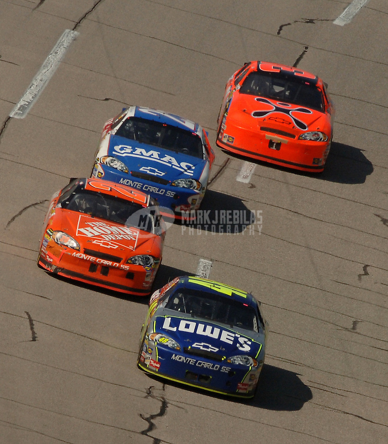 May 1, 2006; Talladega, AL, USA; Nascar Nextel Cup driver Jimmie Johnson of the (48) Lowes Chevrolet Monte Carlo leads Tony Stewart (20) and Brian Vickers (25) through the tri-oval on the final lap to win the Aarons 499 at Talladega Superspeedway. Mandatory Credit: Mark J. Rebilas.