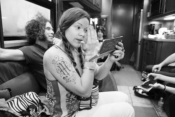 Zia McCabe applies her make-up inside The Dandy Warhols tour bus before their show at the Mercy Lounge in Nashville, Tennesse on May 5th, 2014.