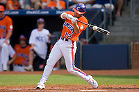 Wilson Boyd #12 of the Clemson Tigers makes contact with the baseball at Durham Bulls Athletic Park May 22, 2009 in Durham, North Carolina.  (Photo by Brian Westerholt / Four Seam Images)