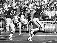 Oakland Raiders #54 Terry Mendenhall racing with fumble recovery, along with #89 Drew Buie. (1971 photo/Ron Riesterer)