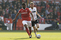 (L-R) Molla Wague of Nottingham Forest followed by Oli McBurnie of Swansea City during the Sky Bet Championship match between Nottingham Forest and Swansea City at City Ground, Nottingham, England, UK. Saturday 30 March 2019