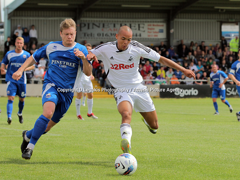 Pictured: Casey Thomas of Swansea (R) challenged by Legh de-Vulgt of Port Talbot (L). Saturday 17 July 2011<br /> Re: Pre season friendly, Port Talbot Football Club v Swansea City FC at the GenQuip ground, Port Talbot, south Wales.