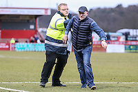 A Northampton Town fan is removed from the field during the Sky Bet League 2 match between Stevenage and Northampton Town at the Lamex Stadium, Stevenage, England on 19 March 2016. Photo by David Horn / PRiME Media Images.