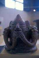 Mayan seated man stone figure (Early Classic period, 300-600 AD),  in the on-site museum at Tazumal ruins, El Salvador