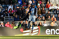 Conor Casey (6) of the Philadelphia Union goes up for a header with Lawrence Olum (13) of Sporting Kansas City. Sporting Kansas City defeated the Philadelphia Union 2-1 during a Major League Soccer (MLS) match at PPL Park in Chester, PA, on October 26, 2013.