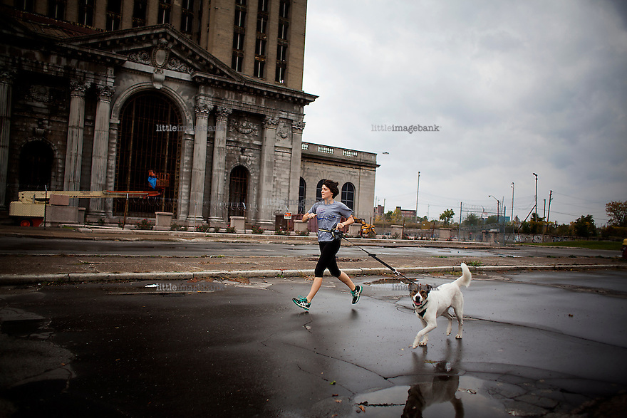 Detroit, Michigan, USA. A woman goes for a run with her dog in downtown Detroit. The state of Michigan once was concidered a promised land, in the era of the american automobile industry adventure. Due to the financial crisis, the state is on the brink of economic and social colapse. Fifty years ago, the city of Detroit was home of two million residents. In 2012 only 700.000 residents remain, and 87 percent of the remaining residents are African Americans. The gap between rich and poor in Detroit are as great as in the Philipines. Photo: Christopher Olssøn.