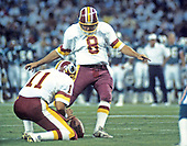 Washington Redskins place-kicker Chip Lohmiller (8) prepares to kick a field goal as quarterback Mark Rypien (11) holds the ball during a pre-season game against the Miami Dolphins at RFK Stadium in Washington, D.C. on August 25, 1989. The Redskins won the game 35 - 21.<br /> Credit: Arnold Sachs / CNP