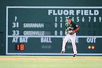 Shortstop Carlos Asuaje (20) of the Greenville Drive hops as he gets set for the pitch in a game against the Savannah Sand Gnats on Sunday, June 22, 2014, at Fluor Field at the West End in Greenville, South Carolina. Greenville won, 7-3. (Tom Priddy/Four Seam Images)
