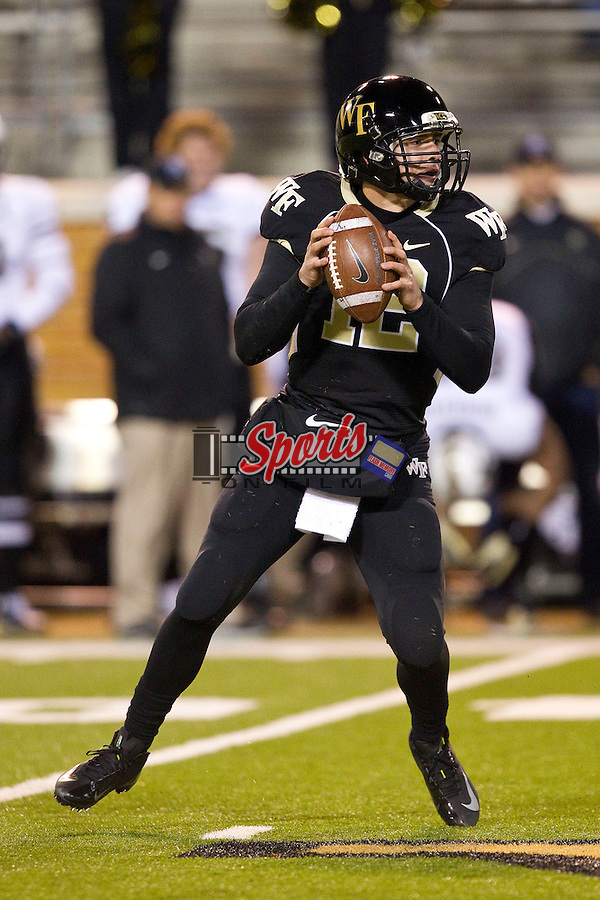 Wake Forest Demon Deacons quarterback Brendan Cross (12) drops back to pass during second half action against the Vanderbilt Commodores at BB&T Field on November 24, 2012 in Winston-Salem, North Carolina.  The Commodores defeated the Demon Deacons 55-21.  (Brian Westerholt/Sports On Film)