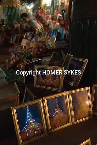 Pilgrims souvenirs for sale Shwedagon Paya temple Yangon Myanmar ( Rangoon Burma ) 2006