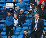 "A Rangers fan in the East Enclosure holds up a banner reading ""Green Out"""