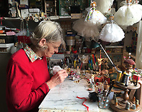 BNPS.co.uk (01202 558833)<br /> Pic: PhilYeomans/BNPS<br /> <br /> Dinah starts work early in her tiny workshop in Chiswick.<br /> <br /> Fairy Grandmother - Bespoke fairy maker Dinah Nicholson gets a helping hand from grandchildren Franka, Carla and Daisy this Christmas...<br /> <br /> Described as a 'Living National Treasure' by Country Life magazine her unique creations have even been supplied as wedding gifts for bridesmaids at Royal weddings.<br /> <br /> Each of her 4159 creations so far have been logged in a fairy ledger, and the £60 cost has never been increased as 'I want everyone to be able to afford one'.