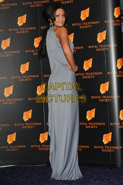 MICHELLE KEEGAN.The Royal Television Society (RTS) Awards, Grosvenor House Hotel, Park Lane, London, England, UK,.March 15th 2011..full length grey gray blue maxi dress sleeveless looking over shoulder tanned fake tan hand on hip.CAP/CJ.©Chris Joseph/Capital Pictures.