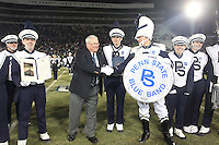 State College, PA - 11/29/2014:  Dr. O. Richard Bundy is honored at halftime. Bundy will retire at the end of the season after 18 years as director of the band. Michigan State defeated Penn State by a score of 34-10 at Beaver Stadium on Senior Day, Saturday, November 29, 2014. <br /> <br /> Photos by Joe Rokita / JoeRokita.com<br /> <br /> Photo &copy;2014 Joe Rokita Photography